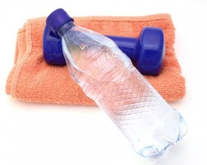 Photo of a weight, towel and bottle of water